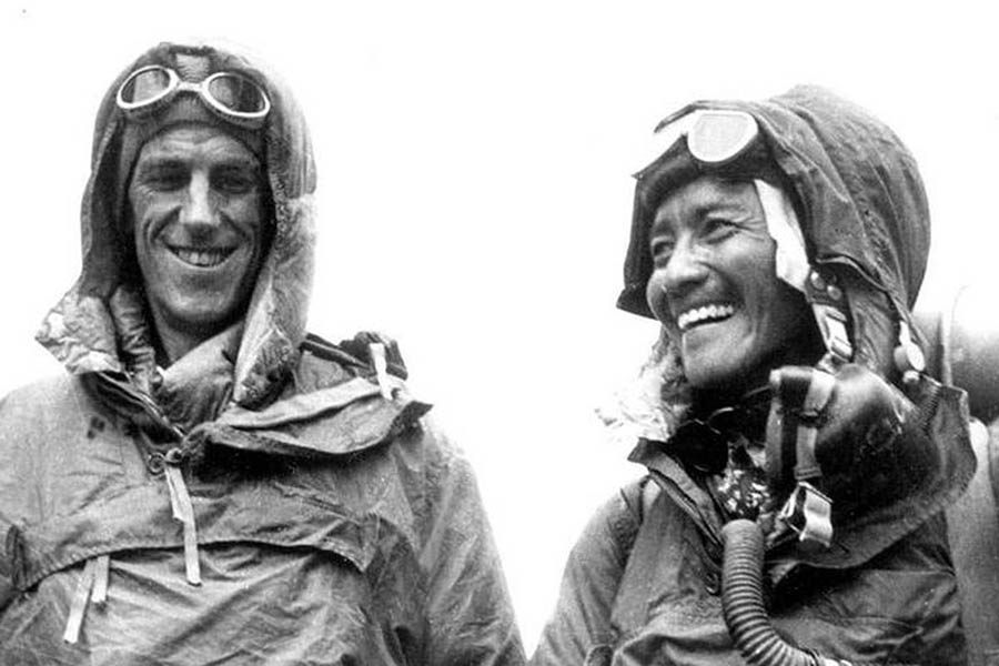 Sir Edmund Hillary (L) and Tenzing Norgay Sherpa display their climbing gear at the British Embassy in Kathmandu following their conquest of Mount Everest in 1953 in this undated handout photograph. Nepali Sherpa friends of Sir Hillary, who died on January 11, 2008, lit butter lamps and offered special Buddhist prayers in monasteries for the mountaineer, calling him a great philanthropist and friend of Nepal. Hillary, who scaled Mount Everest in 1953 along with Nepal's Tenzing Norgay Sherpa, spent much of his life afterwards helping Sherpa communities in Nepal, including projects to build hospitals and schools. REUTERS/Picture Norgay Archive/Handout (NEPAL).  EDITORIAL USE ONLY. NOT FOR SALE FOR MARKETING OR ADVERTISING CAMPAIGNS. - RTX5GOK